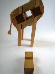 Casse-tête - Girafe - Guy Brette - première pièce enlevée