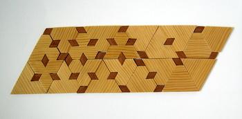 Casse-tête - Triangle à entailles - parallelogramme (Jean Brette)